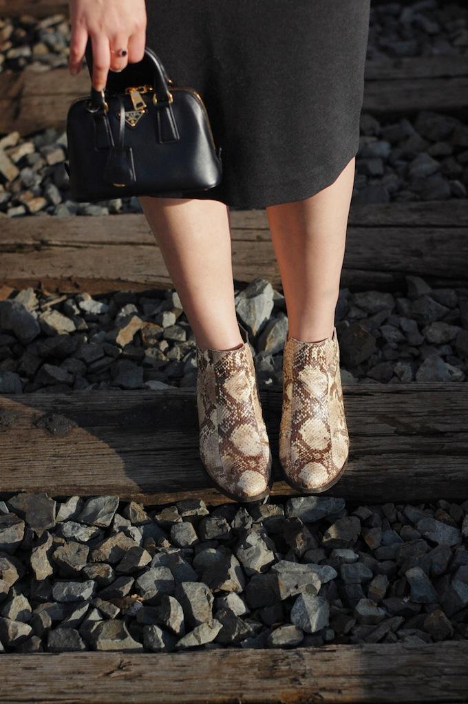 Vince Camuto Corral snakeskin boots and mini Prada bag