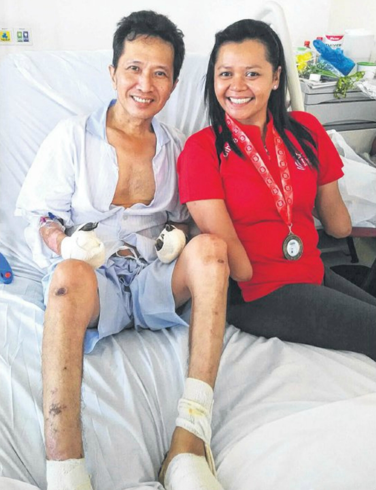 SHOWING THE WAY: When Mr Tan saw Ms Aishah enter his ward, he was moved to tears. His hands and feet have to be amputated.