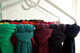 use a hanger to store scarves