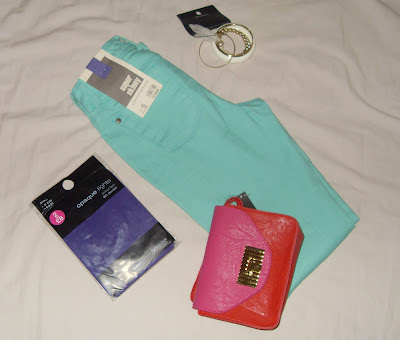 aqua jeans, gold/cream bracelet, purple tights and a red+ fuchsia clutch