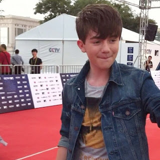Greyson Chance biting his lip on the red carpet before MTV Awards in Beijing