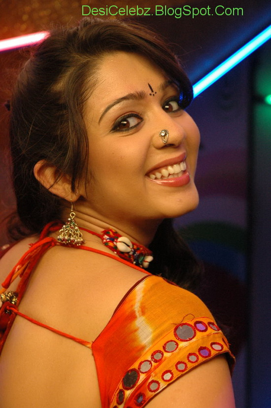 Charmi Hot stills in Red saree