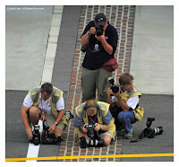 Photographers shooting famous bricks Indianapolis Grand Prix 2002