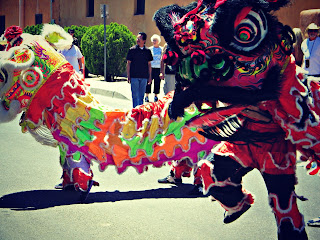 Chinese dragons dance during Founder's Day in Albuquerque's Old Town