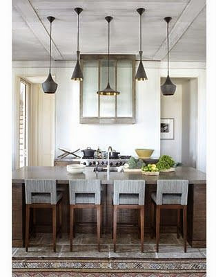 gorgeous kitchen with five hanging pendant lights