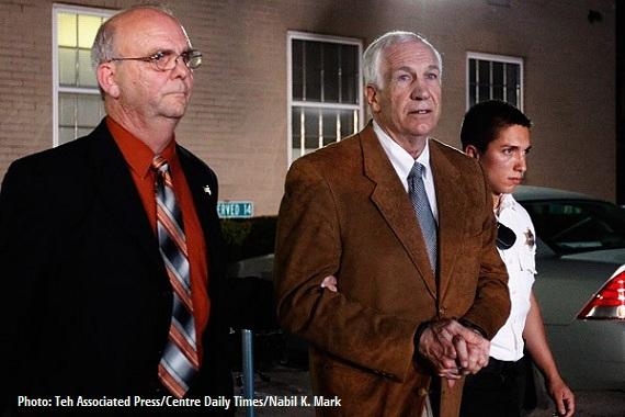 Penn State pedophile Sandusky is led to jail.