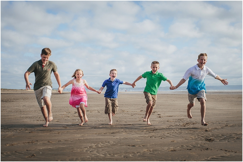 Children running on the sand at Saunton Sands