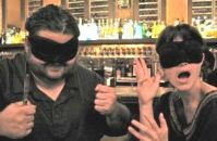 Two blindfolded diners hamming it up.