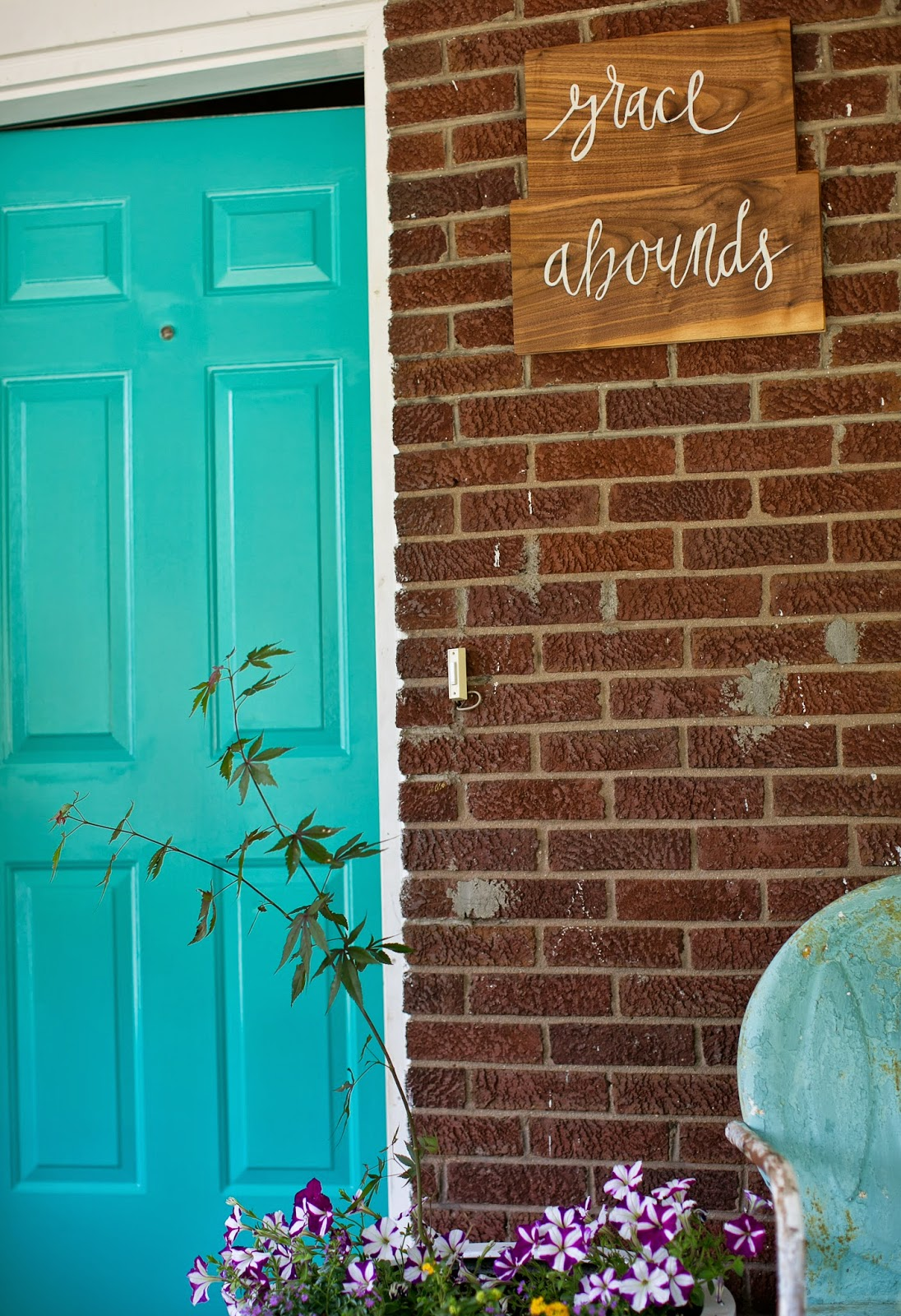 "Bright blue door and ""grace abounds"" hand-lettered sign"