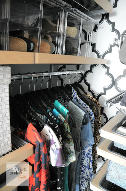 Pop of wallpaper and clear shoe storage in the master closet :: OrganizingMadeFun.com