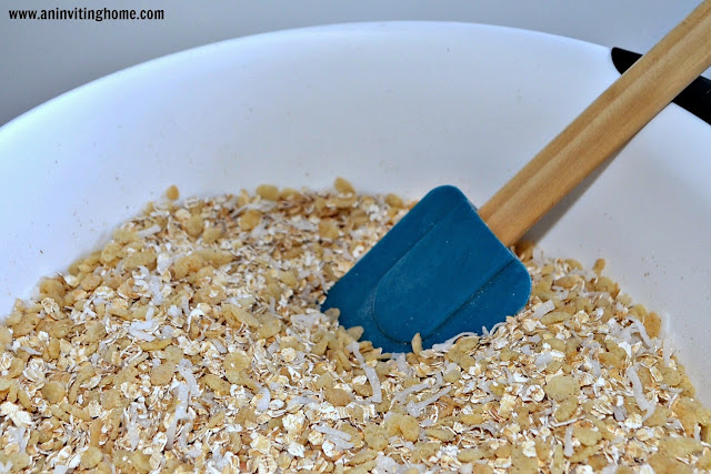 mixing granola with oats, rice cereal & coconut