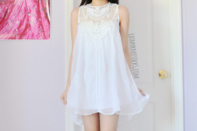 SheIn's white high-neck crochet/lace shift dress is a super-cute summer dress, with sheer detailing and a flowy bodice.