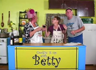 Nosey Norma takes a break from her waitress duties to cook something up on Cooking it up with Betty