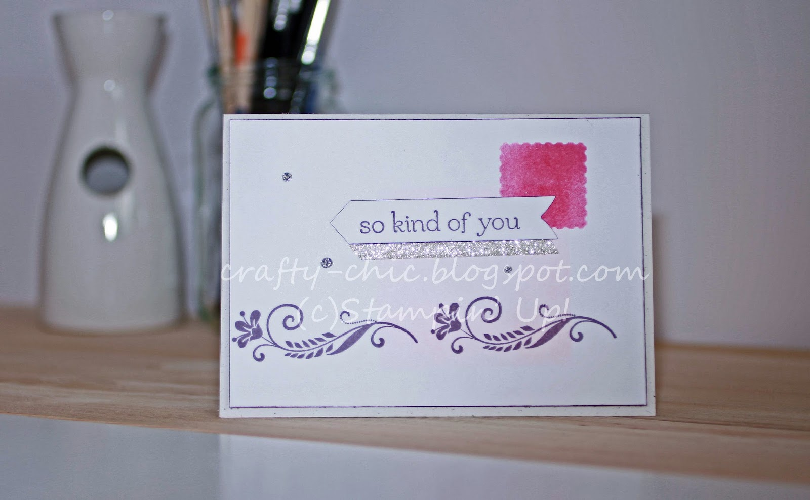 A card with flowers stamped on the bottom
