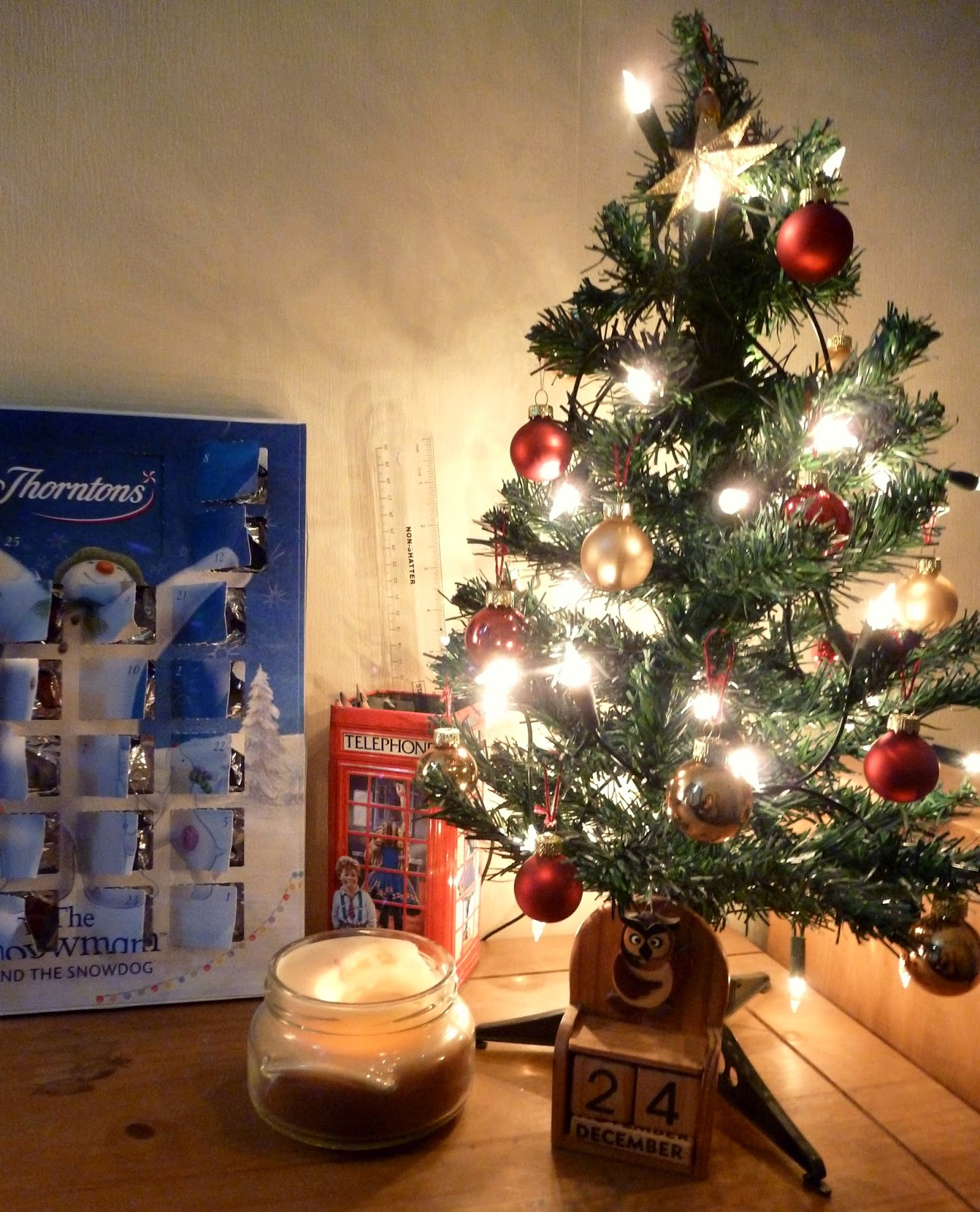 Thorntons chocolate advent calender and christmas tree with lights and baubles