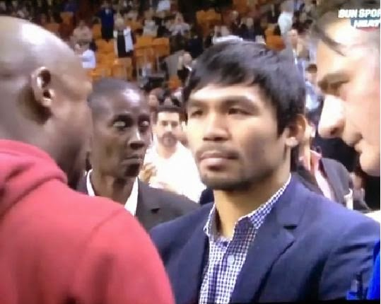 Manny Pacquaio and Floyd Mayweather talking at the center court of the Heat Game