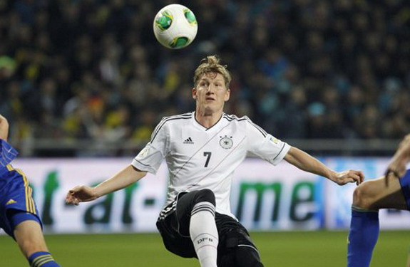 Germany player Bastian Schweinsteiger controls the ball before scoring against Kazakhstan