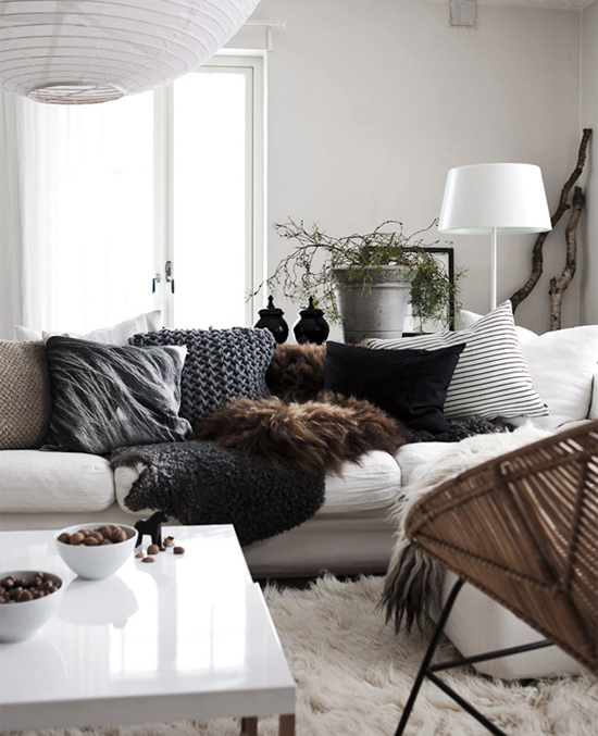 Lots of furry and shaggy textures create a welcoming warmth in the living room of Daniella Witte