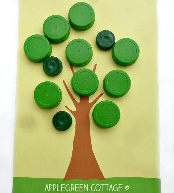 apple search bottle cap activity for kids. It's an easy DIY game for kids of all ages. It's made using plastic bottle caps - reused materials that already have at home, at no cost. It's a colorful play with red apples and green leaves. Ready for some apple hunting fun? Have a look!