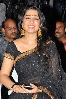 Actress Charmi Kaur Pictures in Black Saree at Jyothilakshmi Trailer Launch  40.JPG