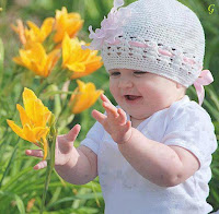Cute Baby in White Dress With yellow flowers Images