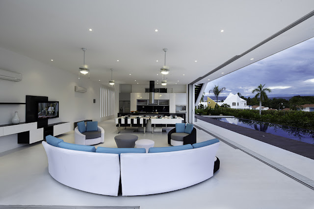 Modern living room with curved furniture
