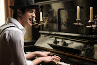 Man singing and playing the piano