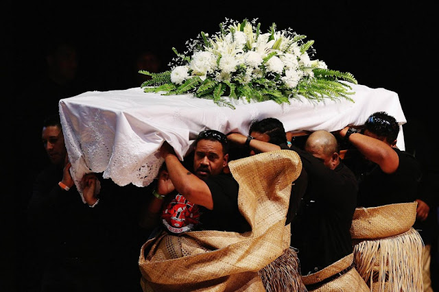 The casket containing Jonah Lomu is carried out. Photo: AFP