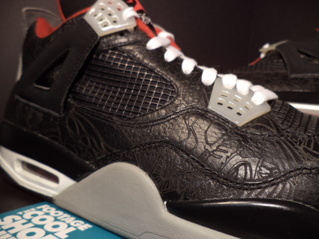 ... the original Air Jordan IV. We see matching white laces also put to use  with grey and red accents 023e648ddf