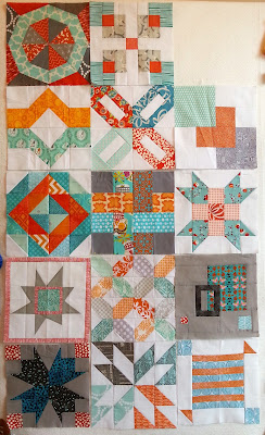 14 aqua and orange quilt blocks, each one a different design