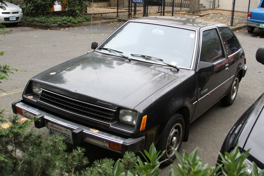 OLD PARKED CARS.: 1982 Plymouth Champ Hatchback.
