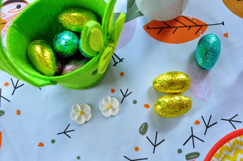 Easter bunny baskets and easter eggs on an easter party table