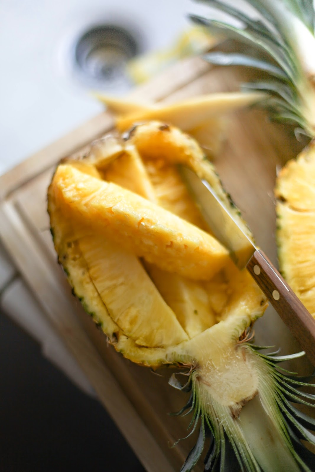 How to Carve a Pineapple Fruit Basket | via Chandara Creative