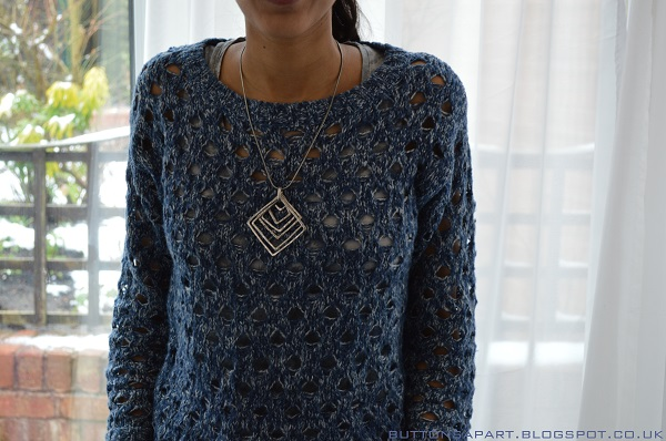a picture of a outfit featuring a blue knitted jumper