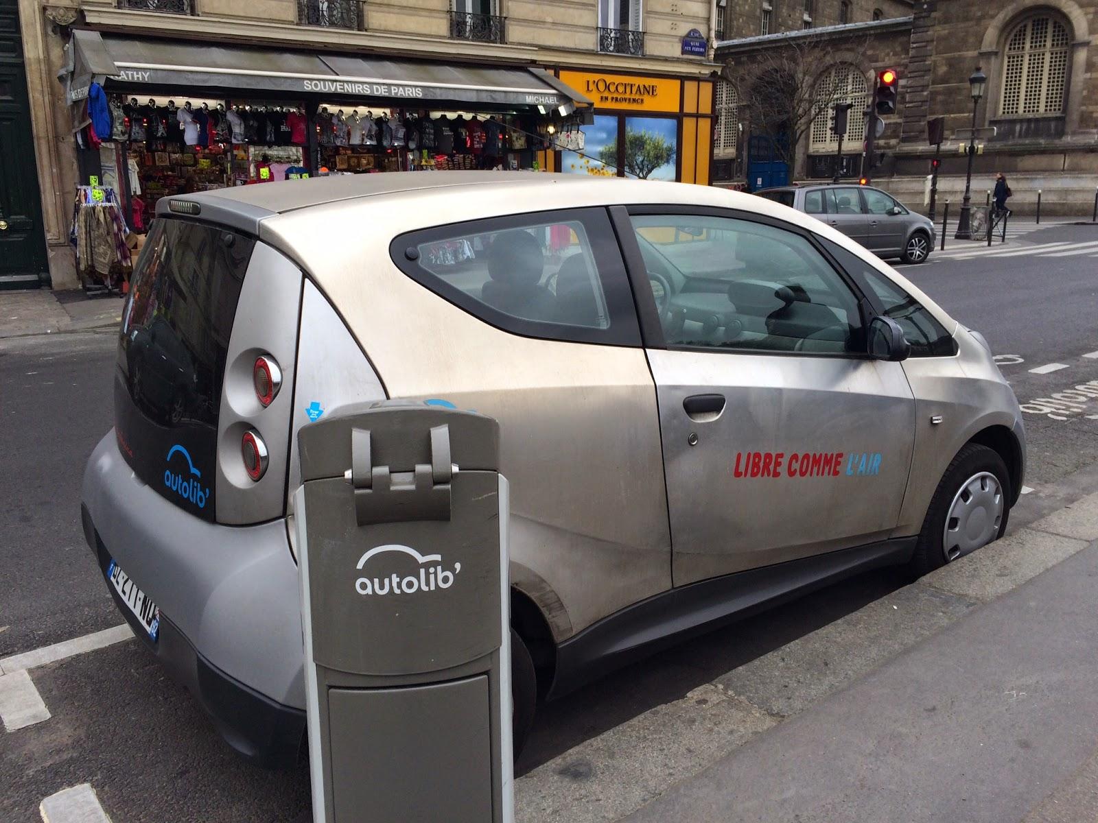 Pic of electric car recharging in Paris street