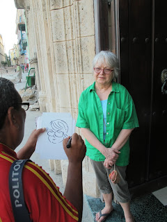 A street artist sketches our travel companion Virginia