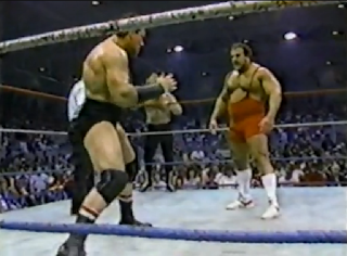 Iron Mike Sharpe prepares to lock up with Ted Arcidi in a WWF wrestling match in Brantford Ontario in 1986.