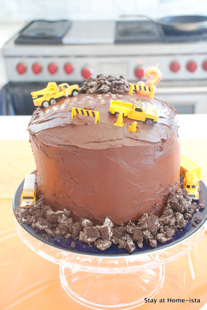 chocolate construction truck cake with cookie rocks and dirt