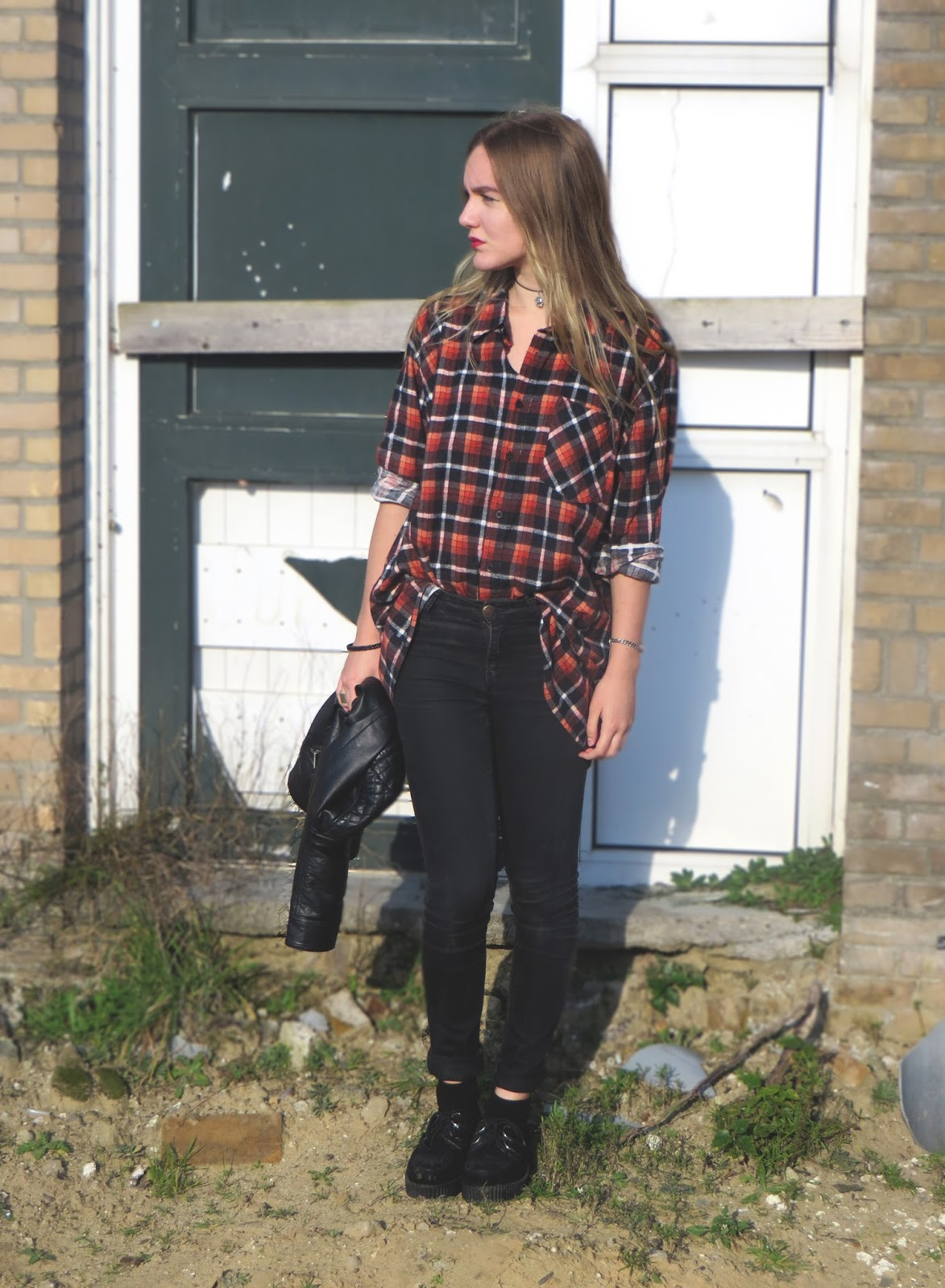 outfit with plaid or tartan shirt, black jeans, leather jacket and creepers