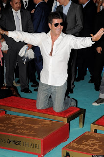 Simon Cowell praying