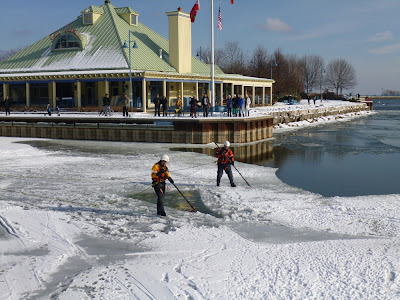 Firemen probing ice thickness of Credit River at Snug Harbour, Mississauga, ON