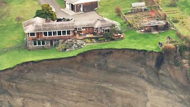 http://silentobserver68.blogspot.com/2013/03/earth-opens-up-in-massive-landslide-on.html
