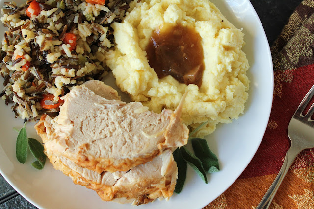 thanksgiving turkey dinner with mashed potatoes, gravy and wild rice stuffing