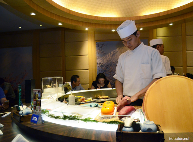 Chefs preparing your fine Japanese dishes at ISHIN
