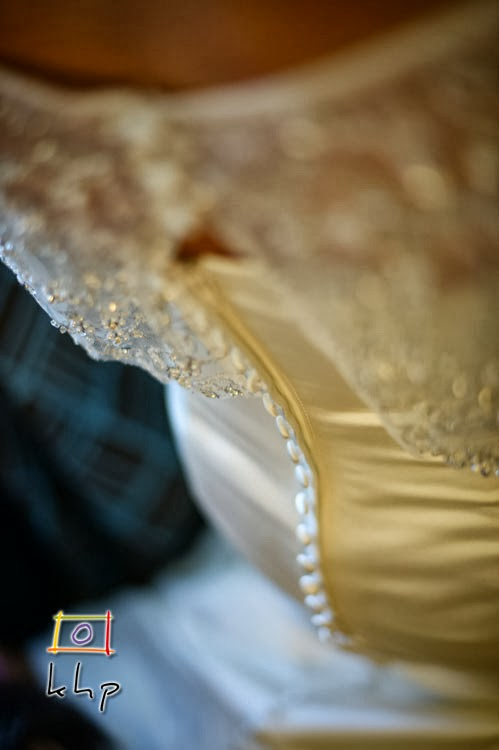 A detail shot off the bride's wedding gown
