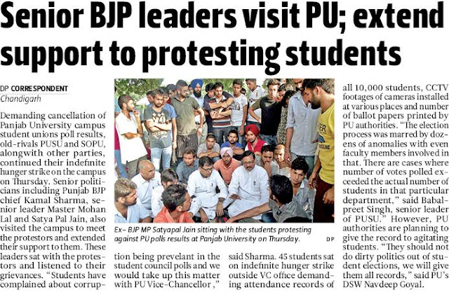 Ex-BJP MP Satya Pal Jain sitting with the students protesting against PU polls results at Panjab University on Thursday.