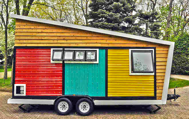 it may look like a colorful toy box for children but it is a working tiny house for those who love to move from place to place made from modern materials