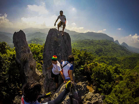 Hikers crawling and exploring the Mt. Sipit Ulang Rock formations
