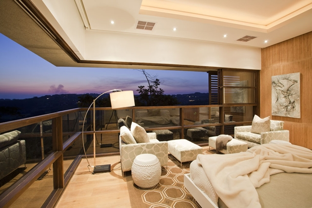 Bedroom with open corner window and amazing views out of Contemporary South African SGNW House by Metropole Architects
