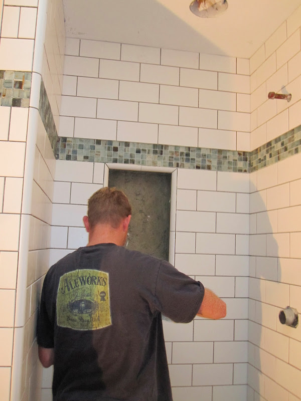 Update December 7, 2012: Rocky working on the tile and the trim in the  title=